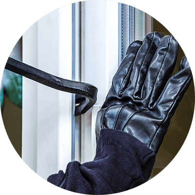 Gloved burglar breaking into a house