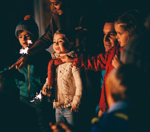 kids holding sparkler