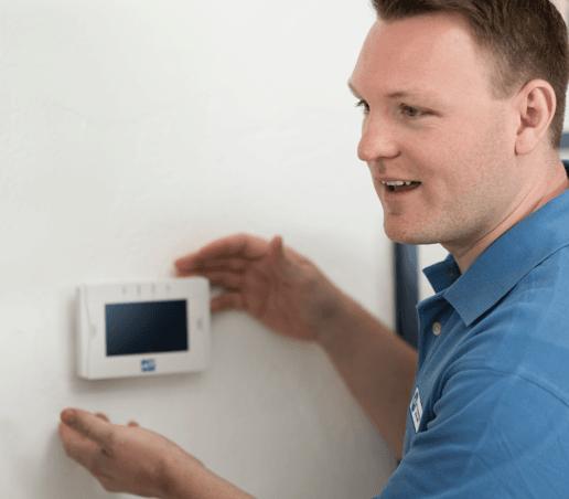 Home security technician installing keypad
