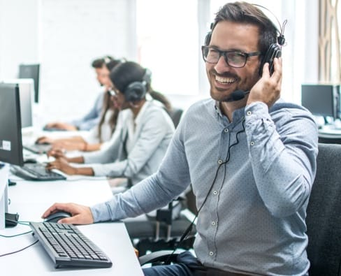 Customer support rep wearing headset
