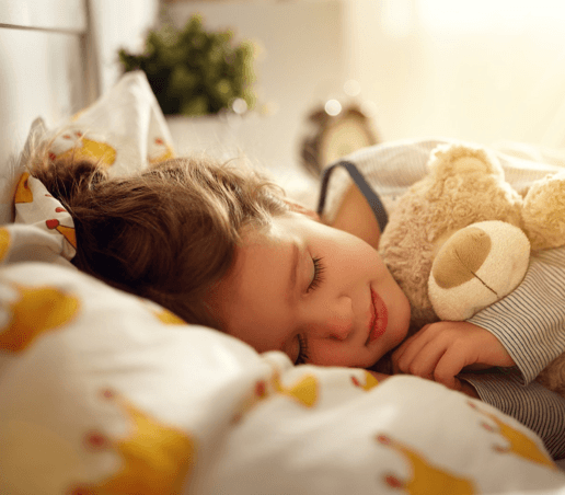 little girl sleeping with teddy bear