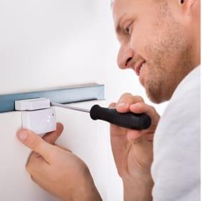 Technician installing sensor