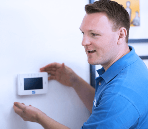 Technician installing home security keypad