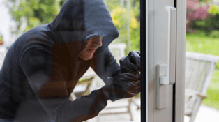 Image of burglar attempting to break into home