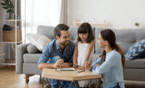 Image of family playing games in living room