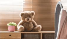 Teddy bear sitting on shelf