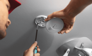 Image of man installing a carbon monoxide detector