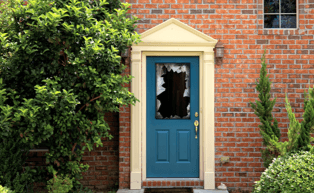 Image of door with broken glass