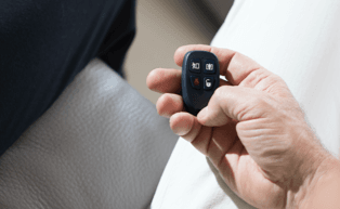 Image of hand holding security key fob