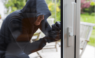 Image of an intruder trying to break in through a door