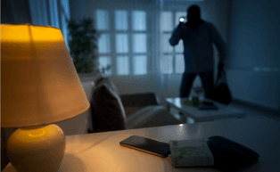 Image of an intruder inside a home at night