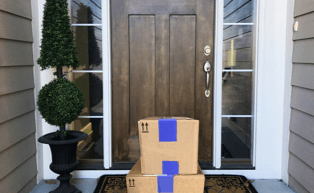 Image of front door with packages on doorstep